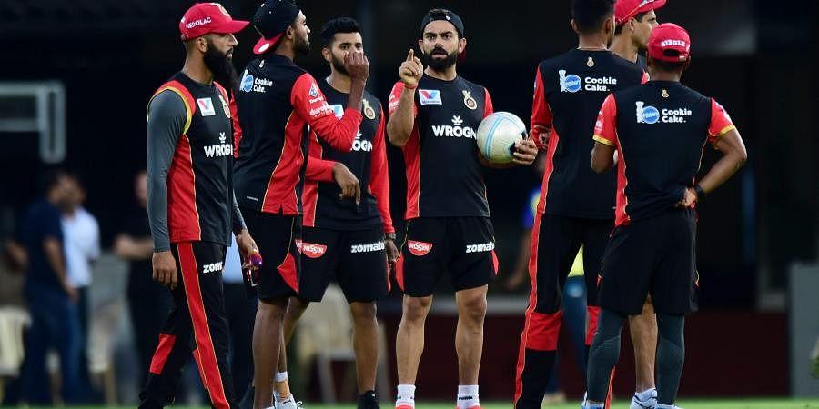 Skipper of Royal Challengers Bangalore RCB Virat Kohli along with teammates at a practice session. (Photo | PTI)