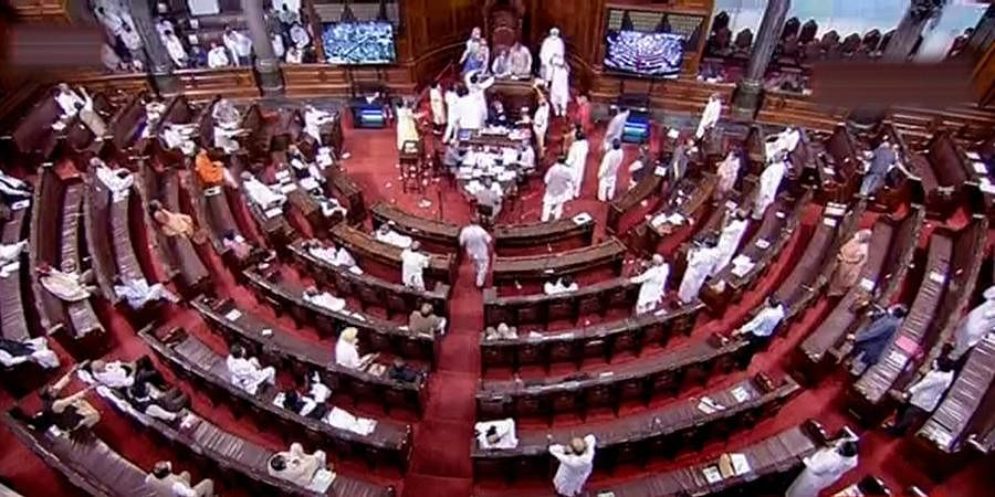 Ruckus erupts in the Rajya Sabha as Opposition rushes to Well of House over agriculture related bills during the ongoing Monsoon Session at Parliament House in New Delhi.