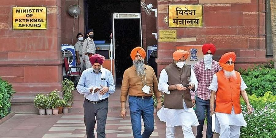 Members of Delhi Sikh Gurdwara Management Committee come out after a meeting with MEA joint secretary regarding kidnapping of the Sikh girl