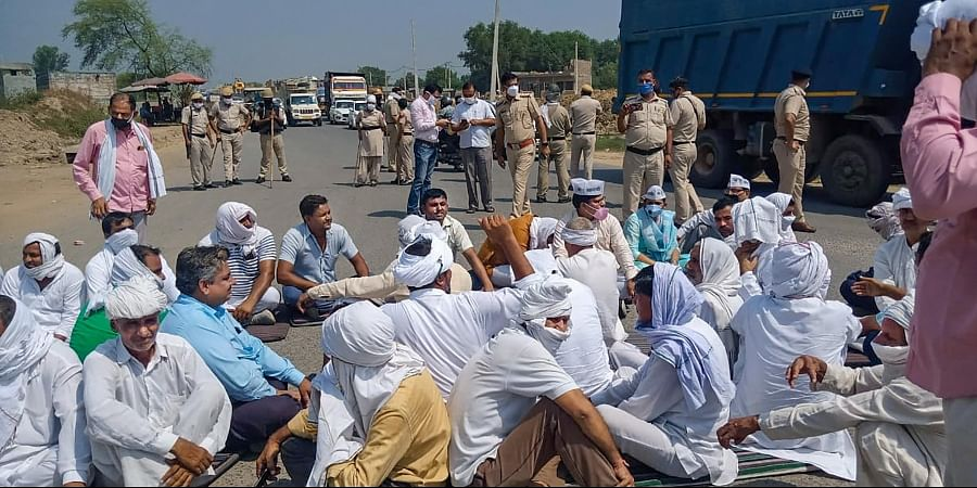Members of various farmer associations stage a protest against Central Government over agriculture related ordinances in Sonipat district.