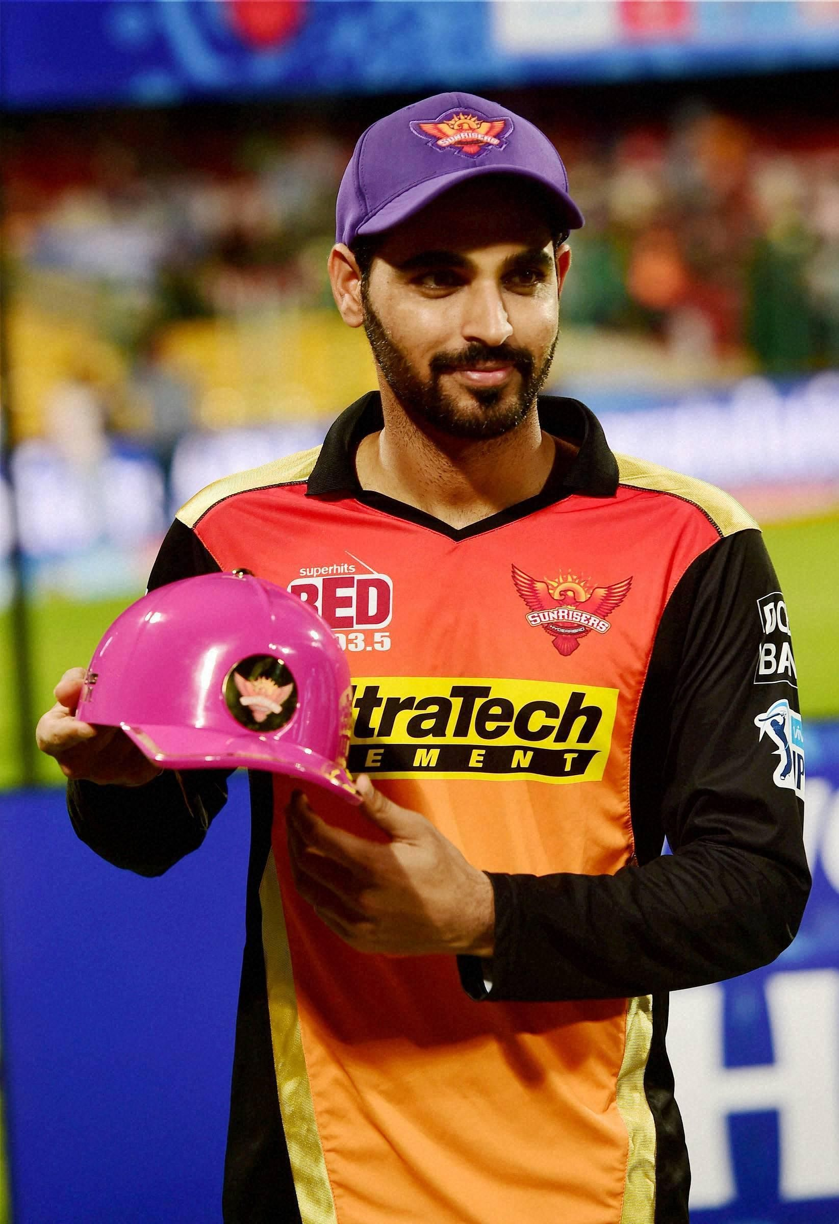 Purple Cap: An actual cap that's given to the leading wicket-taker during the IPL. Only four Indians have won this (Bhuvneshwar Kumar, RP Singh, Pragyan Ojha and Mohit Sharma). In picture, Sunrisers Hyderabad Bhuvneshwar Kumar poses with the purple cap. (File Photo | PTI)