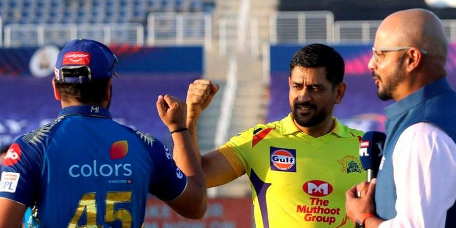 New normal: The IPL will be held under bio-secure bubble settings. Players will have to undergo regular testing. There will be no spectators, no handshakes. It will be a big test for everyone involved. In picture, Mumbai Indians captain Rohit Sharma and Chennai Super Kings skipper MS Dhoni opt for a fist bump instead of a traditional handshake. (Photo | PTI)