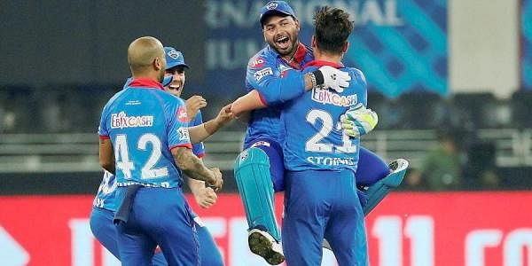 Delhi Capitals players celebrate after defeating Kings XI Punjab in the super over during the cricket match of IPL 2020 at Dubai International Cricket Stadium. (Photo | PTI)