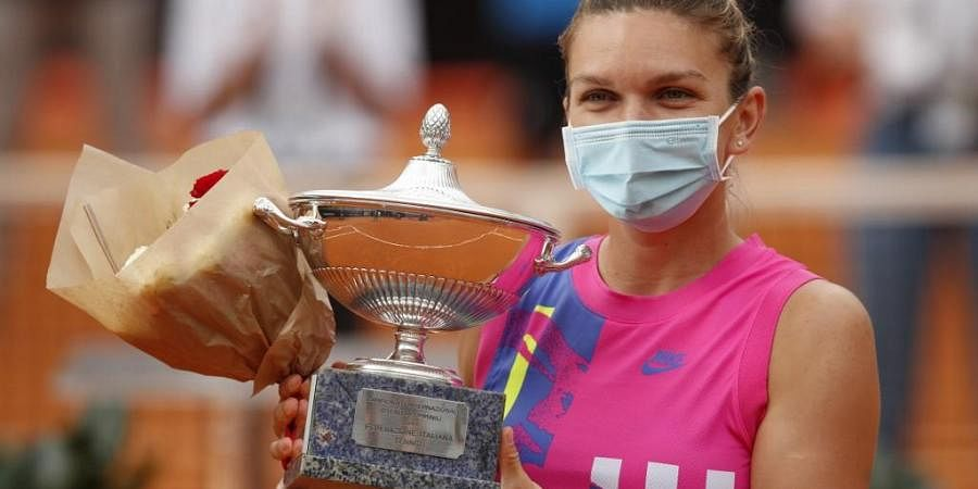 Romania's Simona Halep poses with her trophy after winning the final match of the Women's Italian Open against Czech Republic's Karolina Pliskova. (Photo | AFP)