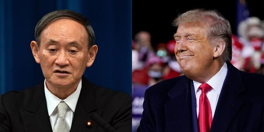 Newly-elected Japan PM Yoshihide Suga (L) and US president Donald Trump