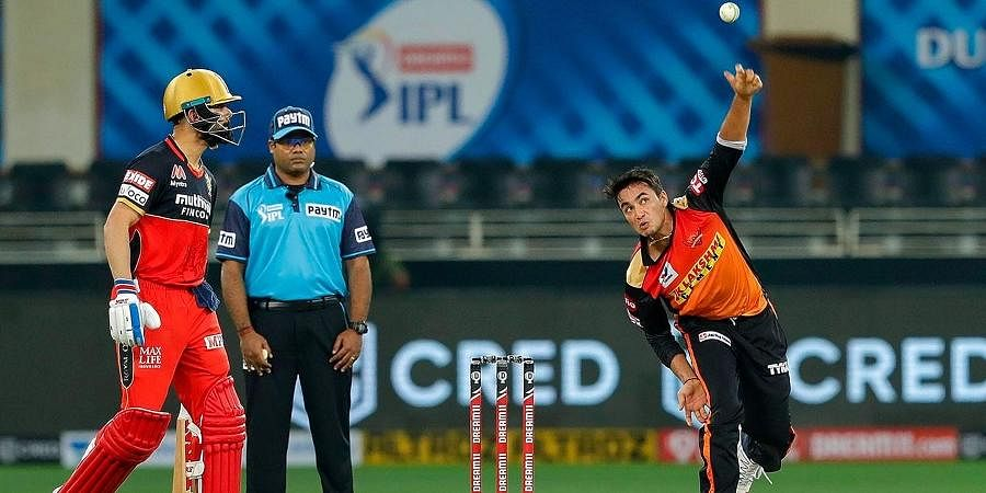 Sunrisers Hyderabad'sAbhishek Sharma bowls as Virat Kohli watches | PTI