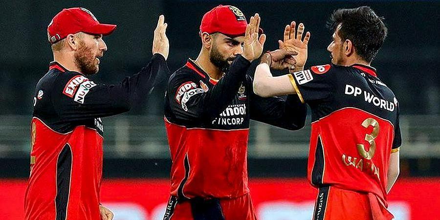 RCBplayerscelebrate the wicket of SRHbatsman Manish Pandey during a cricket match of IPL 2020 at Dubai International Cricket Stadium.
