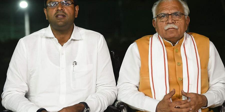 Haryana Chief Minister Manohar Lal Khattar and JJP leader Dushyant Chautala