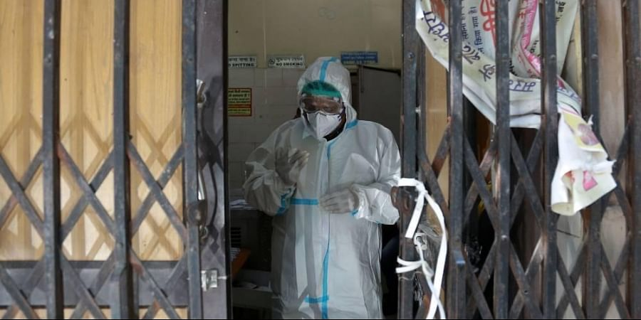 A health worker during the collection of samples for coronavirus test inside a testing centre in New Delhi.