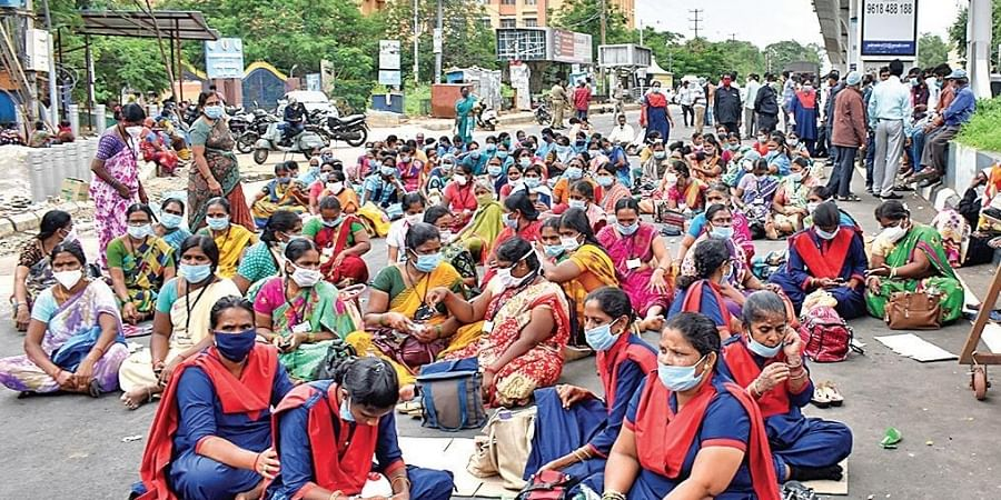 Outsourced sanitation staff stage a protest at Gandhi Hospital demanding salary hike and regularisation of services. (Photo | S Senbagapandiyan, EPS)