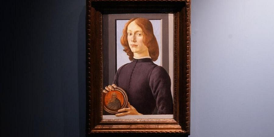 Sandro Botticelli's 15th-century painting called 'Young Man Holding a Roundel' is displayed at Sotheby's. (Photo|AP)