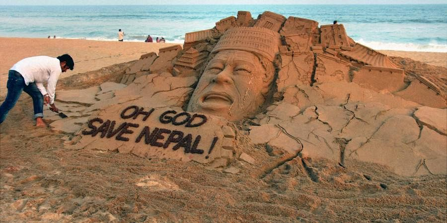 Puri Sand artist Sudarsan Pattnaik creates sand sculpture on Nepal earthquake. (Photo| PTI)