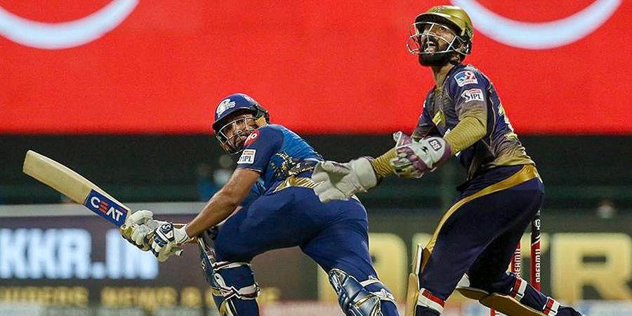 Mumbai Indians captain Rohit Sharma plays a shot during IPL 2020 cricket match against Kolkata Knight Riders at Sheikh Zayed Stadium.