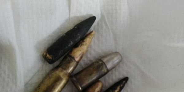 Police suspected that someone might have tried to get rid of the bullets by tossing them in the washroom.