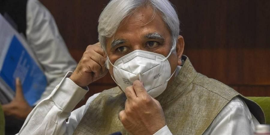 Chief Election Commissioner Sunil Arora wears a mask at a press conference to announce the schedule for Bihar Assembly Elections 2020