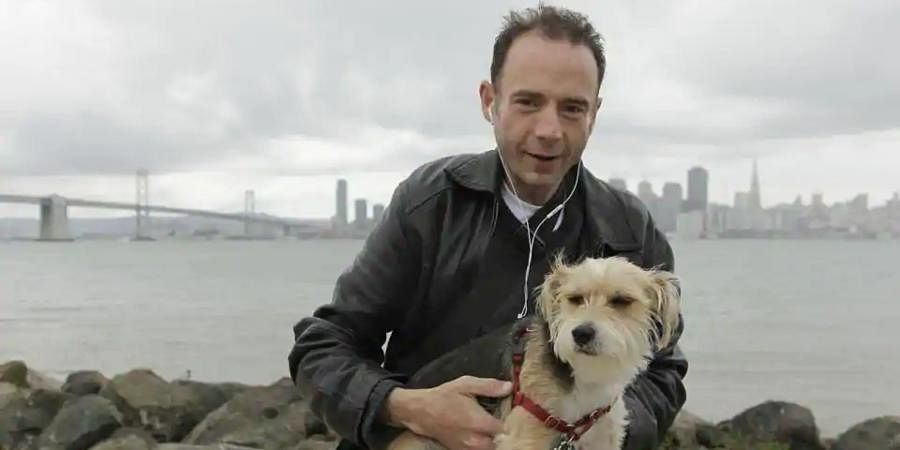 This May 16, 2011 photo shows Timothy Ray Brown with his dog, Jack, on Treasure Island in San Francisco.