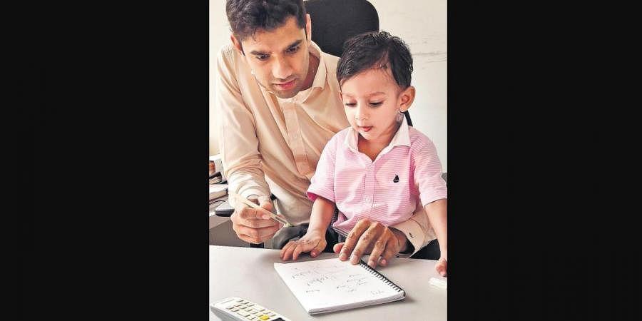 Raghav Himatsingka with his son