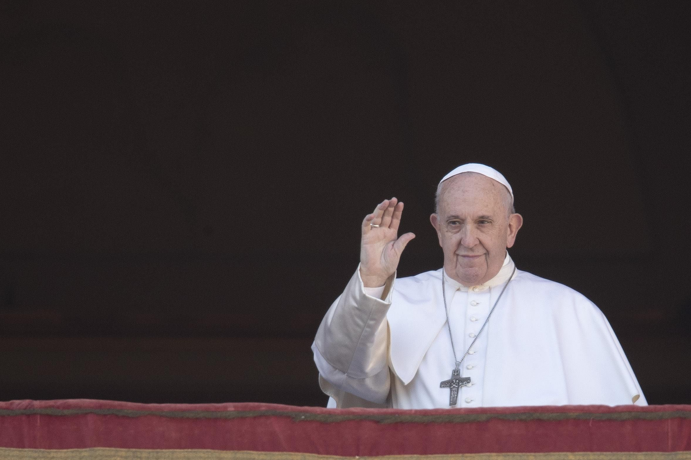 Pope Francis waves to faithful as he arrives to deliver the Urbi et Orbi (Latin for 'to the city and to the world' ) Christmas' day blessing from the main balcony of St. Peter's Basilica at the Vatican. (Photo | AP)