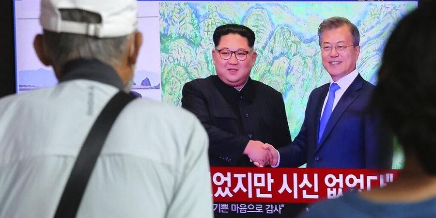 North Korean leader Kim Jong Un, left, and South Korean President Moon Jae-in during a news program