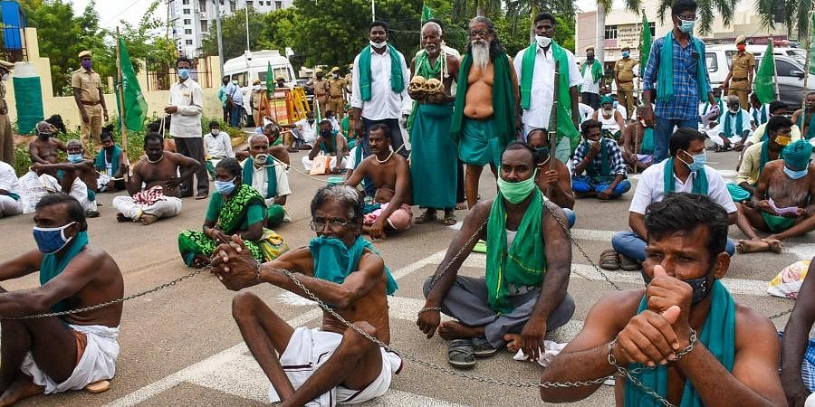 Tiruchy farmers wearing shackles to demonstrate they are bonded by corporate companies through the farm Bills recently passed by the Central government