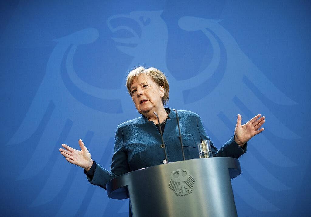 German Chancellor Angela Merkel speaks at a press conference about coronavirus, in Berlin