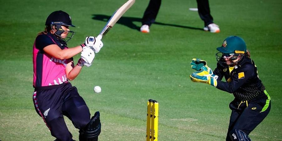 New Zealand's Suzie Bates (L) bats watched by Australia's Alyssa Healy (R) during the Twenty20 cricket match between Australia and New Zealand. (Photo | AFP)
