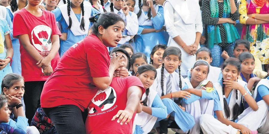 Usha at a camp for school girls; (below) teaching a self-defence technique. (Photo | EPS)