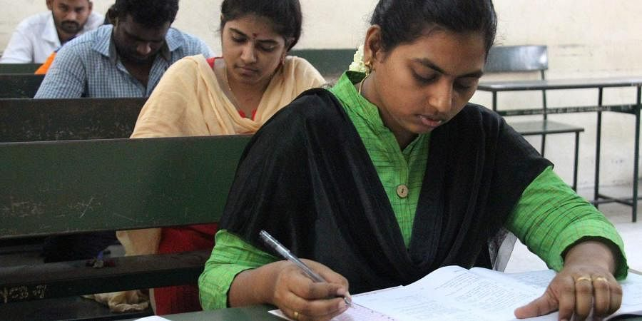 Candidates are seen writing the UPSC Examination in an exam centre at Madurai on Sunday