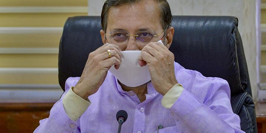 Union I B Minister Prakash Javadekar wearing a protective mask resumes office in New Delhi Monday