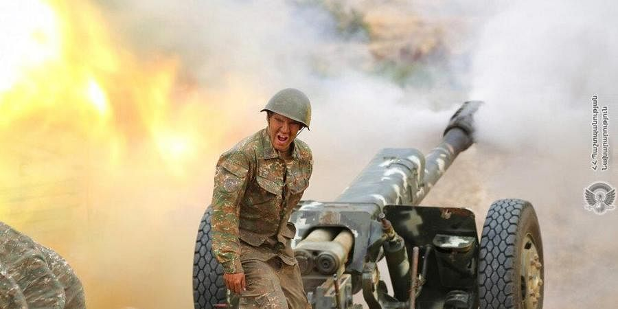 In this photo released by Ministry of Defense of Armenia on Tuesday, an Armenian soldier fires an artillery piece during fighting with Azerbaijan's forces.