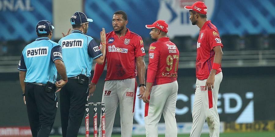 Kings XI Punjab pacer Chris Jordan talks with the umpire.
