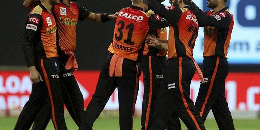 Sunrisers Hyderabad players celebrate the wicket of Delhi Capitals batsman Shreyas Iyer during the Indian Premier League 2020 cricket match, at Sheikh Zayed Stadium, Abu Dhabi