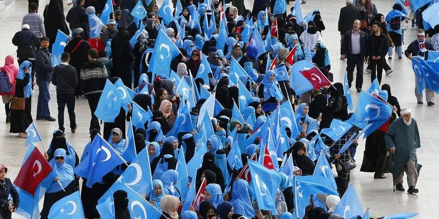 In this file photo dated Tuesday, Nov. 6, 2018, people from the Uighur community living in Turkey carry flags of what ethnic Uighurs call 'East Turkestan', during a protest in Istanbul. (Photo | AP)