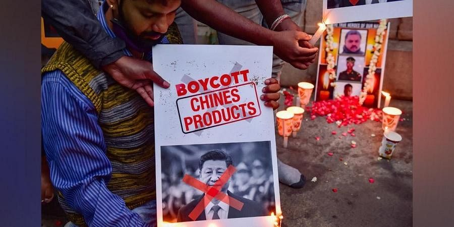 Citizens burn posters of Chinese President Xi Jinping after twenty Indian army personnel were martyred during a clash with Chinese troops in Ladakh's Galwan valley, during the ongoing COVID-19 nationwide lockdown, in Bengaluru. (Photo   PTI)