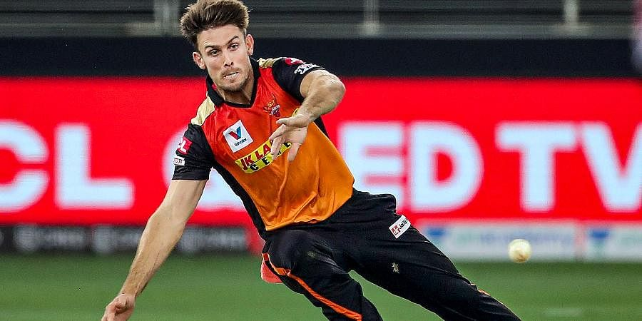Sunrisers Hyderabad player Mitchell Marsh tries to catch ball during a cricket match of IPL 2020 against Royal Challengers Bangalore at Dubai International Cricket Stadium.