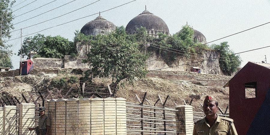 Babri Masjid in Ayodhya before it was demolished by kar sevaks on December 6, 1992.