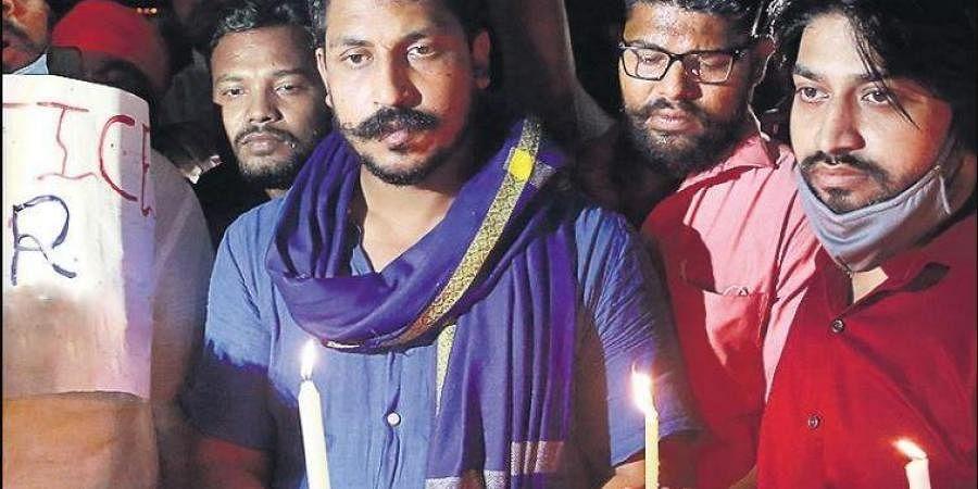 Bhim Army chief Chandrashekhar Azad takes part in a candlelight vigil.