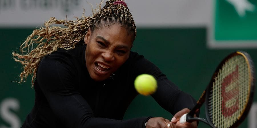 Serena Williams plays a shot against Kristie Ahnin the first round match of the French Open tournament at the Roland Garros stadium in Paris.