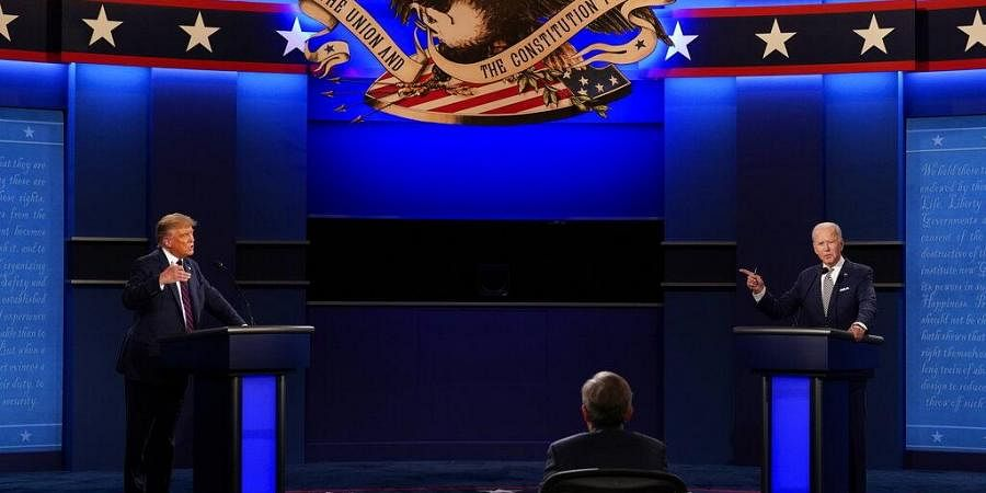 US President Donald Trump, left, and Democratic presidential candidate former Vice President Joe Biden, right, with moderator Chris Wallace, center, of Fox News. (Photo | AP)