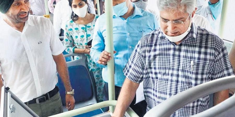 Transport Minister Kailash Gahlot inspects buses being fitted with CCTV, panic buttons & GPS.