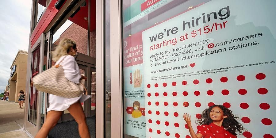 A help wanted sign hangs on the door of a Target store in Uniontown.
