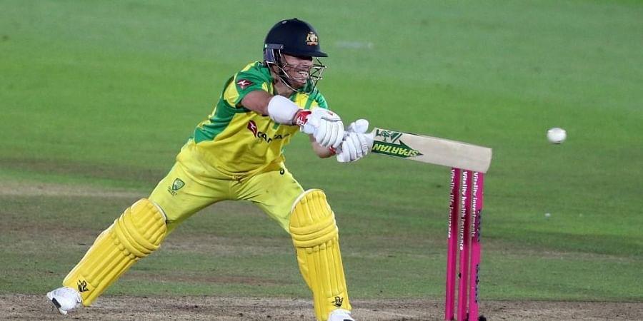 Australia's batsman David Warner stretches to play a shot during the international Twenty20 cricket match between England and Australia. (Photo | AFP)