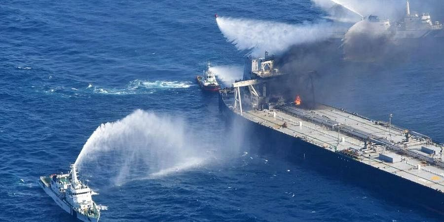 Sri Lanka Air Force, tug boats and ships battle the fire on MT New Diamond, off the eastern coast of Sri Lanka in the Indian Ocean