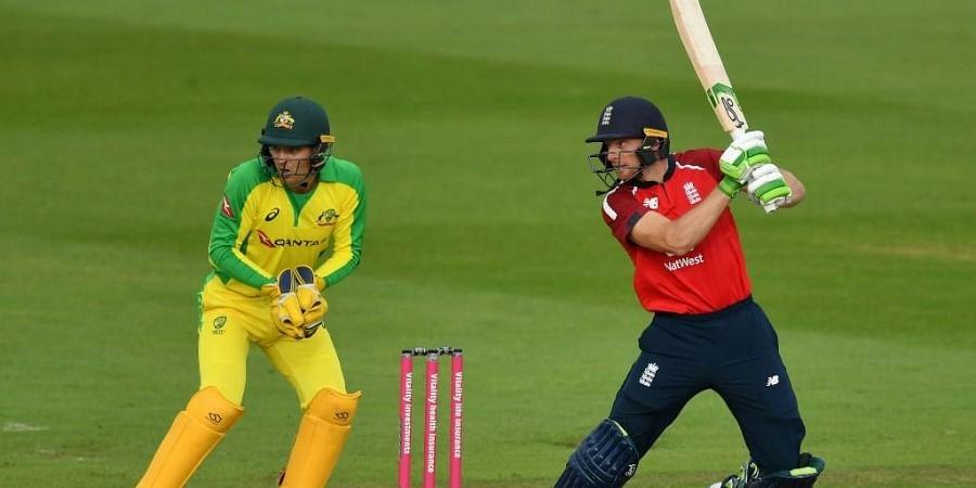 England's Jos Buttler plays a shot (R) during the international Twenty20 cricket match between England and Australia. (Photo   AFP)