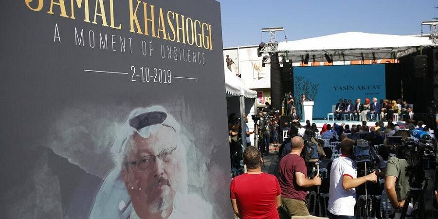 A picture of slain Saudi journalist Jamal Kashoggi, is displayed during a ceremony near the Saudi Arabia consulate in Istanbul.