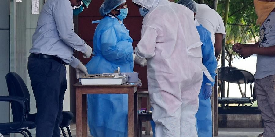 Doctors And Nurses seen working with Personal Protective Equipment PPE.