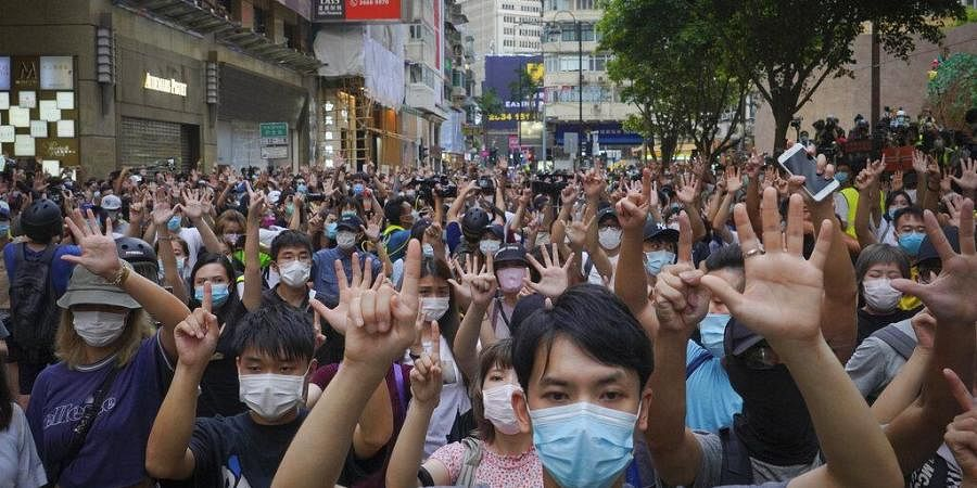 In this photo, protesters against the new national security law gesture with five fingers, signifying the 'Five demands - not one less,' on the anniversary of Hong Kong's handover (File Photo   AP)