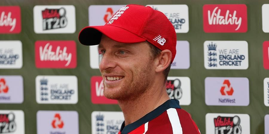 Jos Buttler poses with the Man of the Match award after their win in the second T20 match between England and Australia, at the Ageas Bowl in Southampton.
