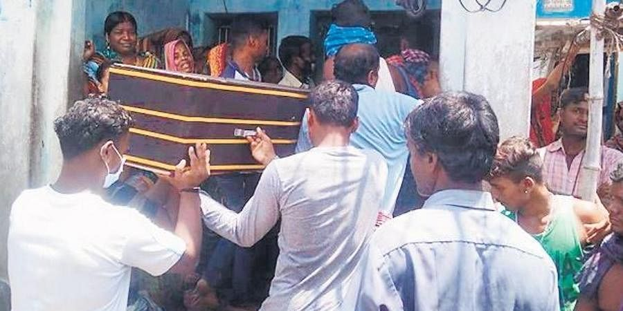 Villagers carry the mortal remains of Kailash Jena in Badiambo village.