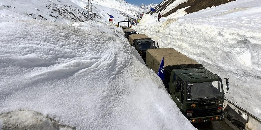 Indian Army convoy passes through Snow Bound Zojila Pass situated at a height of 11,516 feet on its way to frontier region of Ladakh